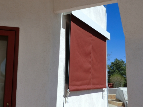 Vertical Roll Curtain with exterior hood and side cables- Rader Awning